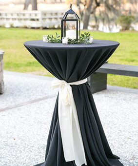 Folding-Cocktail-Tables-With-Black-Tablecloth