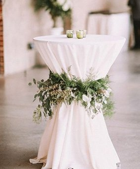 Folding Cocktail Tables With White Tablecloth