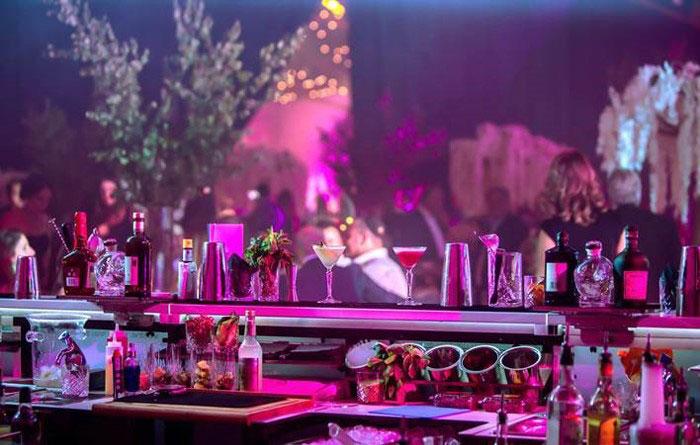 full bartender for rent service serving martini
