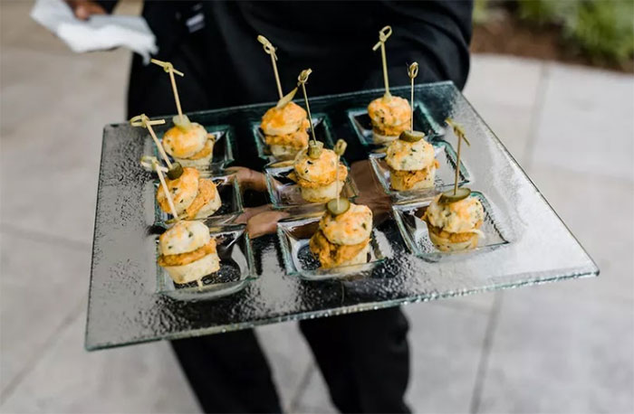 waiting staff agency providing appetizers at party