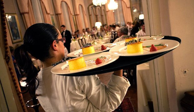 waiters for rent carrying food to guests on tray