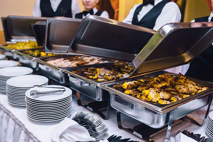banquet waitresses and waiters providing a buffet style meal service at event in toronto